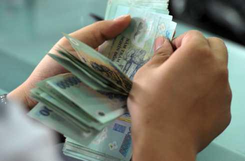 Chính sách tiền lương cơ sởcủa Việt Nam đã nhiều lần được đem ra bàn thảo song vẫn chưa tìm ra phương án cải cách do ngân sách có hạn.Ảnh: PV