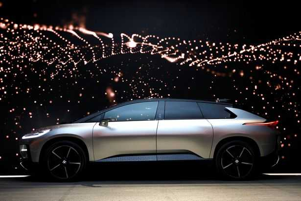 A-Faraday-Future-FF-91-electric-car-is-displayed-on-stage-during-an-unveiling-event-at-CES-in-Las-Ve
