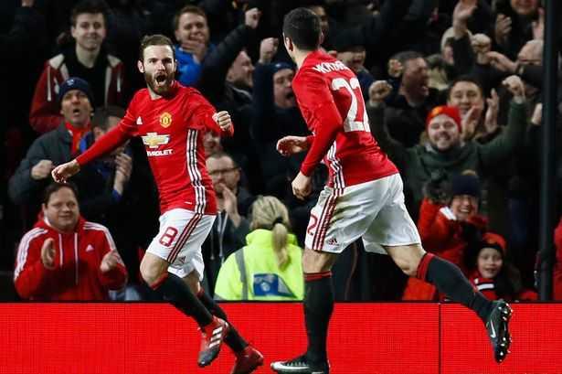 Manchester-Uniteds-Juan-Mata-celebrates-scoring-their-first-goal-with-Henrikh-Mkhitaryan