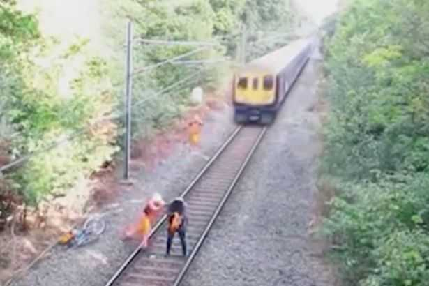 Rail-worker-saves-a-man-on-the-tracks-from-an-incoming-train