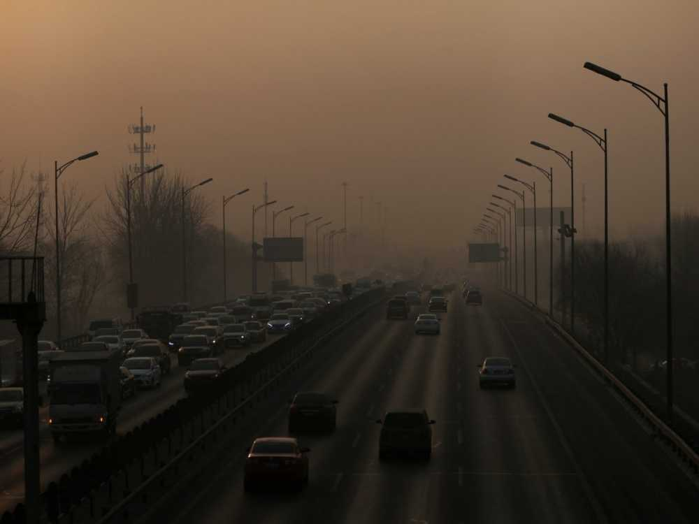 but-after-apec-when-the-worlds-attention-has-turned-away-traffic-resumed-and-the-smog-came-back