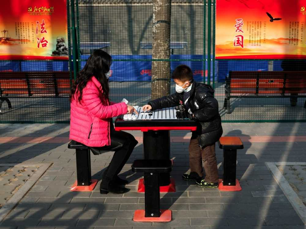 but-life-must-go-on-here-a-mother-and-son-bond-outdoors-despite-a-heavily-polluted-day-in-beijing