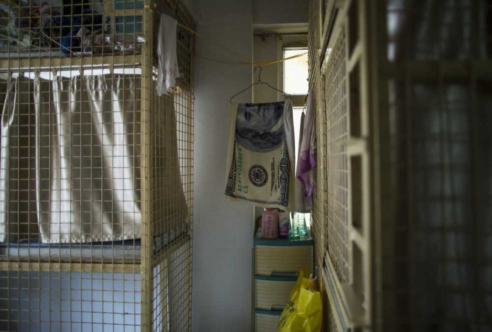 another-style-is-the-cage-home-a-stackable-six-foot-by-two-foot-wire-box-also-located-in-hong-kong