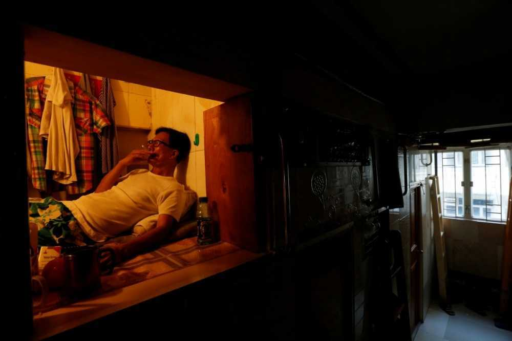 simon-wong-an-unemployed-61-year-old-man-also-living-in-hong-kong-lives-in-a-4x6-box-hes-one-of-many-residents-living-in-coffin-homes