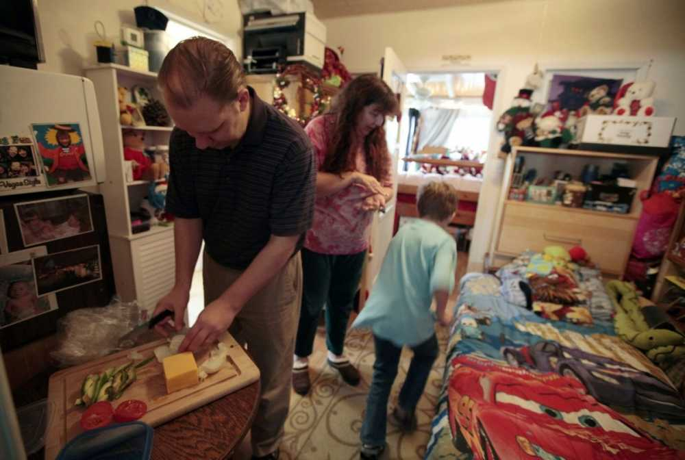 the-burger-family-from-los-angeles-gets-ready-in-a-converted-garage-in-wife-elizabeth-burgers-mothers-home-the-family-lost-their-home-in-2009-and-was-forced-to-sell-their-possessions