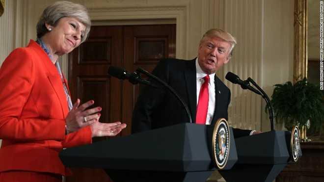 The gioi hoang mang sau lenh cam nhap cu cua Trump hinh anh 2