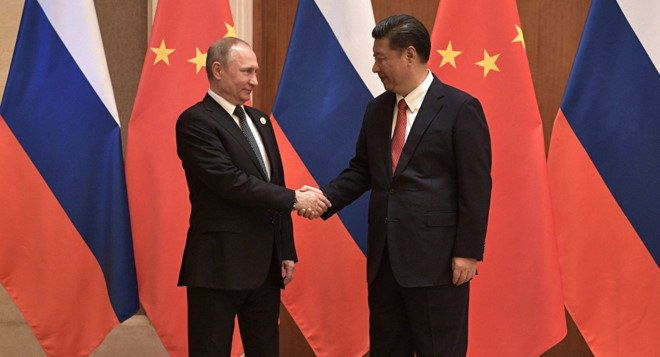 Ong Putin va ong Tap nhat tri tang cuong quan he Nga - Trung hinh anh 1