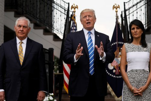U.S. President Donald Trump, flanked by Secretary of State Rex Tillerson (L) and U.S. Ambassador to the United Nations Nikki Haley (R) speaks to reporters after their meeting at Trumps golf estate in Bedminster, New Jersey U.S. August 11, 2017. REUTERS/Jonathan Ernst