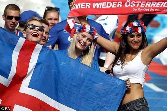 1466610649215_lc_galleryImage_Iceland_fans_cheer_on_the