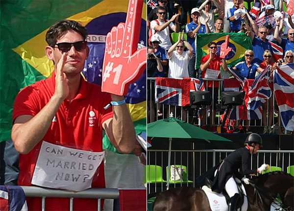 Hôm 15/8, nữ VĐVCharlotte Dujardin đoạt tấm HC vàng đua ngựa cho đoàn thể thao Anh. Bên ngoài đường đua,Dean Wyatt - bạn trai củaCharlotte - nhiệt tình cổ vũ cho cô với tấm biển có dòng chữ