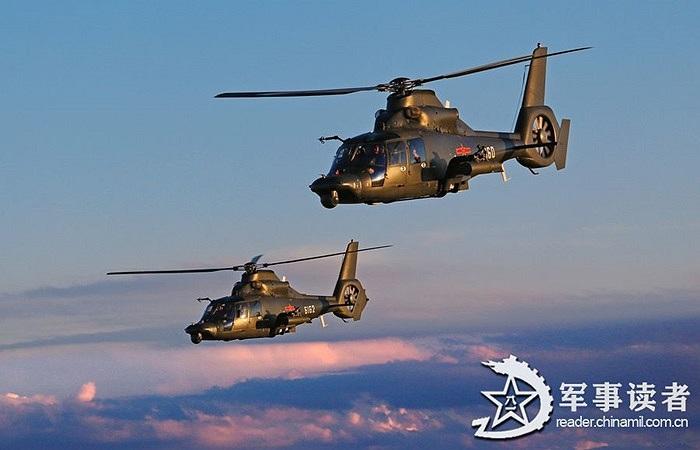 Đội trực thăng vũ trang tham gia hỗ trợ tập trận đổ bộ của các lính dù Trung Quốc