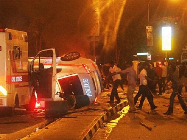 Một đám đông khoảng 400 người đã đụng độ với cảnh sát, sau khi xe buýt tông chết một lao động nhập cư
