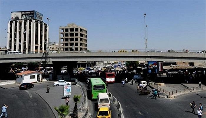 Giao thông trên một con phố ở Damascus hôm 3/9