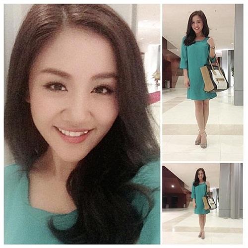 Văn Mai Hương diện váy xanh đi hát.