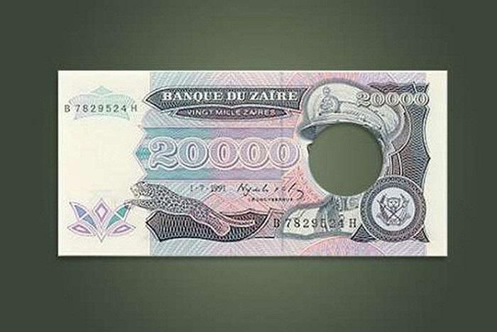 Năm 1997, chế độ độc tài của Joseph Mobutu bị lật đổ, chính quyền mới của Zaire (tên trước đây của Cộng hòa Dân chủ Congo) đã rơi vào cảnh thiếu tiền mặt. Họ đã sử dụng một lượng lớn đồng 20.000 zaire cũ đã được đục bỏ khuôn mặt của Mobutu