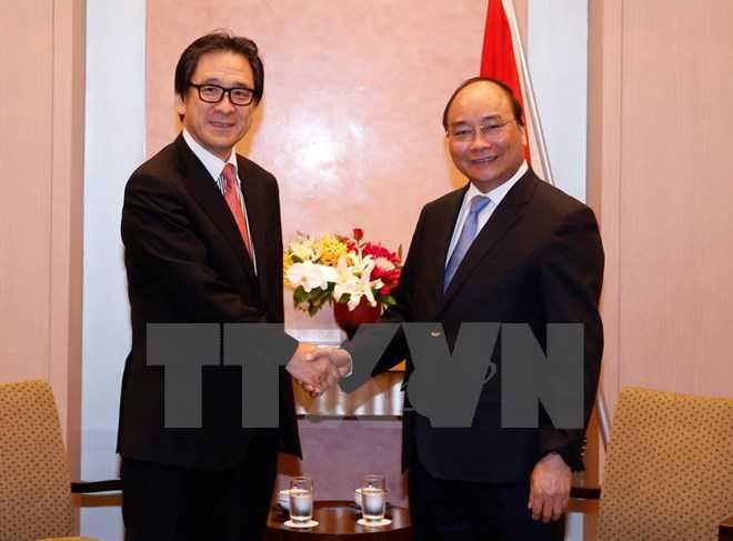 Thủ tướng Nguyễn Xuân Phúc tiếp ông Hiroyuki Ishige, Chủ tịch Cơ quan Xúc tiến Thương mại Nhật Bản - Ảnh: TTXVN