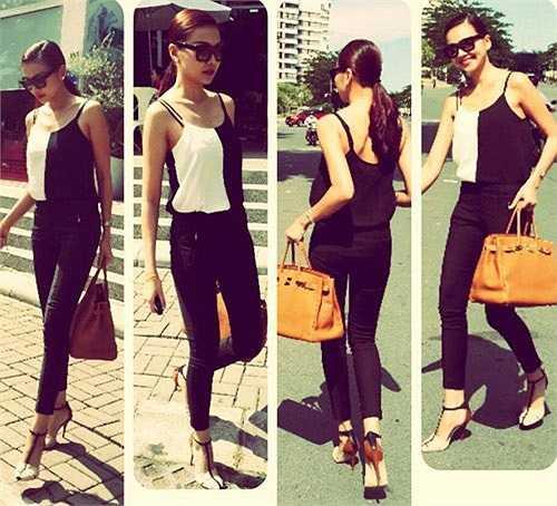 Thanh Hằng phối áo hai dây màu đen trắng với quần skinny jeans rất thanh lịch. (Theo Khám phá).