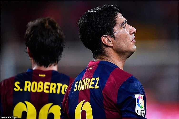 Suarez có vẻ sớm hòa nhập với chiếc áo của Barca