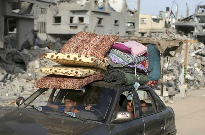 Người trở về nhà của họ ở Beit Hanoun sau khi một lệnh ngừng bắn được tuyên bố giữa Israel và Palestine