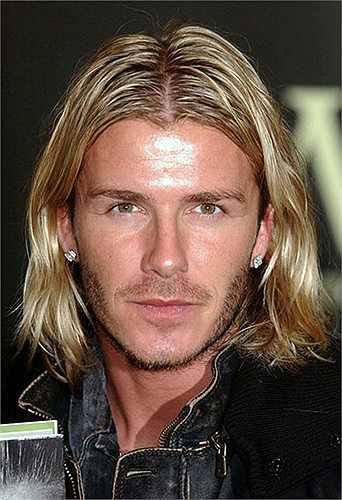 Mái tóc dài như một rocker của ông bố 4 con