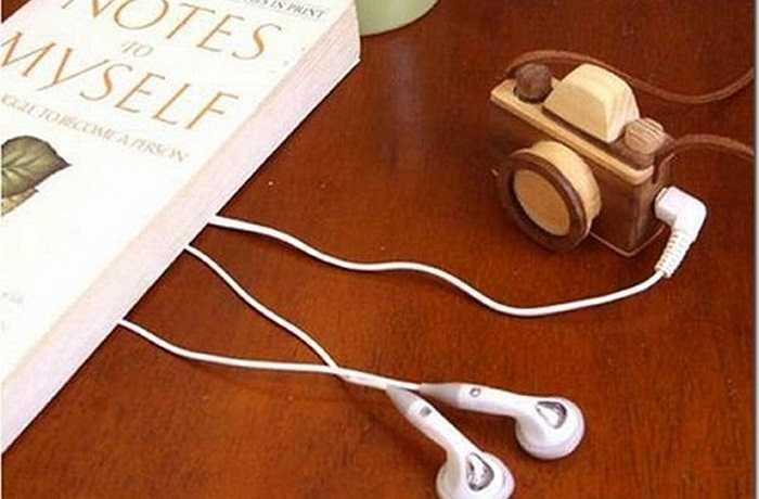 Máy nghe nhạc MP3 có hình dáng giống như chiếc máy ảnh. Nó sẽ giúp bạn thể hiện cá tính và sự đam mê đối với âm nhạc.