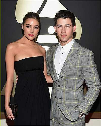 Nam ca sĩ Nick Jonas và bạn gái là Hoa hậu Hoàn vũ 2013 Olivia Culpo cùng nhau sánh bước tới sự kiện lễ trao giải Grammy 2015 diễn ra vào hôm 8.2.2015.