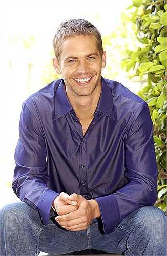 Nụ cười luôn nở trên môi Paul dù anh ở bất cứ đâu. Ảnh chụp trong một buổi họp báo ở Los Angeles năm 2003.