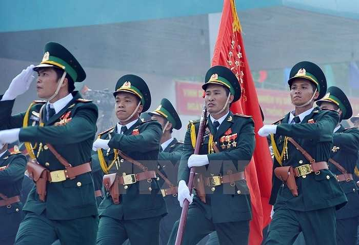 9 / 15  Lực lượng bộ đội Biên phòng tham gia buổi hợp luyện. (Ảnh: Trọng Đức/TTXVN)