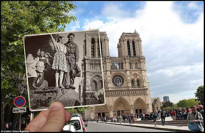 Một thiếu nữ và người lính đứng trên chiếc xe tăng phía trước Nhà thờ Notre Dame, một trong những nhà thờ Gothic được sùng kính nhất thế giới.