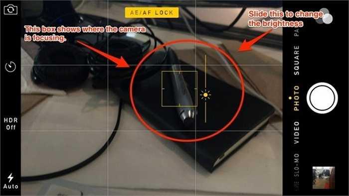 Chạm vào màn hình để lấy nét rồi trượt ngón tay lên hoặc xuống để điều chỉnh sáng tối.