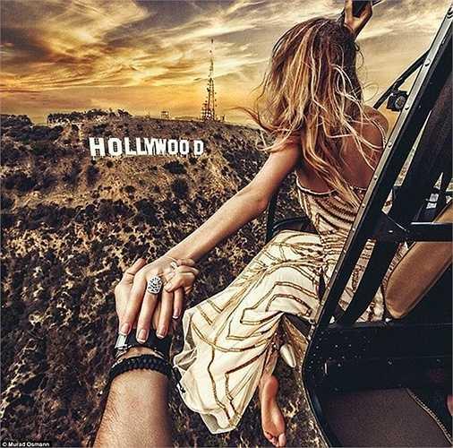 Nhiếp ảnh gia người Nga Murad Osmann cùng vị hôn thê của mình Natalia Zakharova đã đi vòng quanh thế giới để tạo ra những bức ảnh 'Nằm tay em đi khắp thế gian' và hiện đang 'dừng chân' ở Hollywood.
