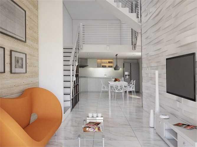 Hoa hậu Ngọc Hân cũng mới cải tạo không gian sống của mình. Cũng chọn tông màu trắng, xám làm chủ đạo, phòng khách của người đẹp được nhấn nhá bằng các đồ nội thất gam màu nóng (cam, đỏ).