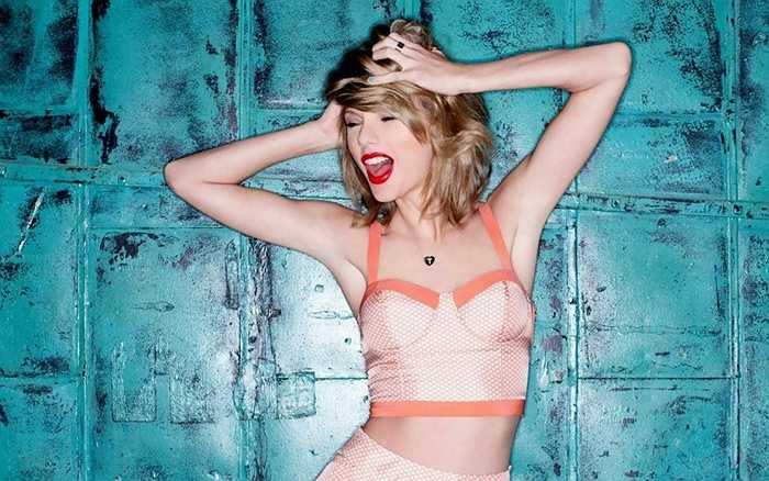 1. Taylor Swift - Lần đầu tiên lọt vào bảng xếp hạng và cũng là nhân vật trẻ tuổi nhất, cô được Forbes ngợi ca là quyến rũ cả thế giới bằng những ca từ thật đẹp và là một nữ doanh nhân đầy ấn tượng.
