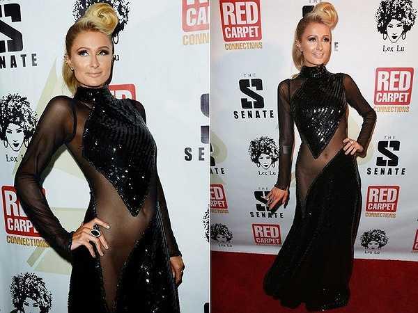 Paris Hilton với hình ảnh quái chiêu khi xuất hiện tại sự kiện thảm đỏ Pre-Grammy Paris. Không chỉ trang phục hở táo bạo mà mái tóc cũng khác người.