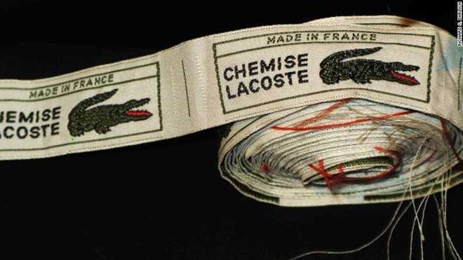 Hàng loạt mác của áo Lacoste được làm sẵn để may vào áo nhái. Ảnh: CNN