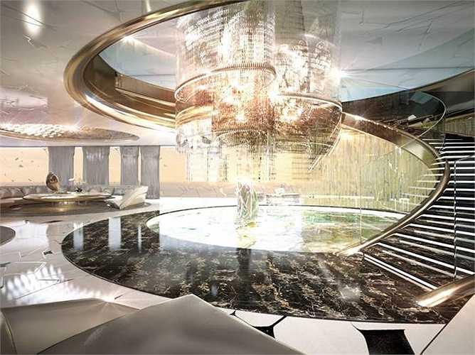 Bên trong du thuyền được thiết kế rất sang trọng. Khu vực sảnh lớn của du thuyền với cầu thang xoắn, đèn chùm rực rỡ