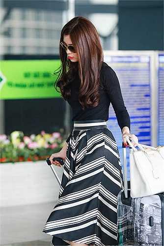 Không chọn scandal hay những phát ngôn sốc để nổi tiếng, Á hậu Việt Nam 2014 lặng lẽ đi theo cách của mình
