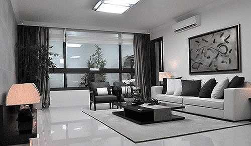 Không gian phòng khách sang trọng và hiện đại với tông màu xám - trắng.