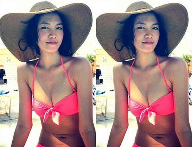 Hoa hậu Thùy Dung hấp dẫn khó tả với đồ bơi màu hồng cam (Nguồn: Khám phá)