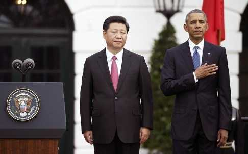 Chủ tịch Trung Quốc Tập Cận Bình và Tổng thống Barack Obama thực hiện nghi lễ tại Nhà Trắng