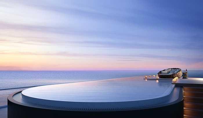Bể bơi vô cực tuyệt đẹp và lãng mạn dưới ánh trời hồng dịu chiều hoàng hôn bên biển. Danh tính người mua căn penthouse này vẫn chưa được tiết lộ
