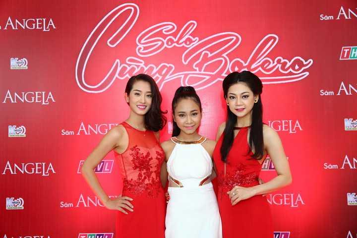 Á quân Giọng hát Việt nhí 2014 Thiên Nhâm (đứng giữa)