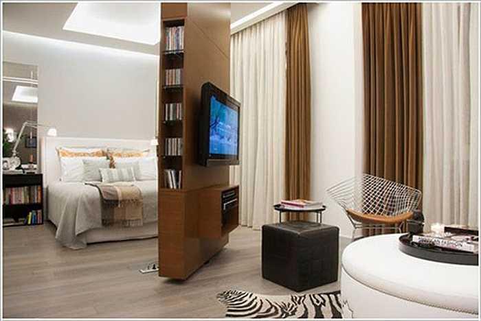 Kệ TV và giá sách xoay. Với lối thiết kế kệ xoay độc đáo, bạn có thể dễ dàng biến không gian căn nhà nhỏ trở nên rộng rãi và lạ mắt hơn.