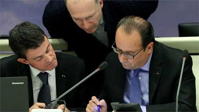 Tổng thống Pháp Hollande (phải) ban bố tình trạng khẩn cấp và đóng cửa biên giới