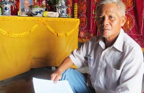 Con ông Huỳnh Chiếm Phái quyết đòi lại danh dự cho cha. Ảnh: TẤN LỘC