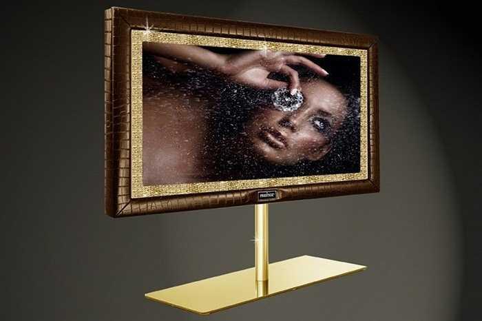3. Stuart Hughes Prestige HD Supreme Edition: 1,5 triệu USD. Lại một chiếc TV được 'chạm trổ' siêu tỉ mỉ và đắt giá. Toàn bộ khung của nó được tạo nên từ 19 kg vàng nguyên chất và 48 viên kim cương, đá quý.