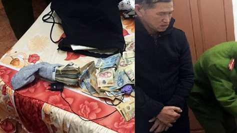Đối tượng cùng số tiền giả bị cơ quan bắt giữ tại khách sạn