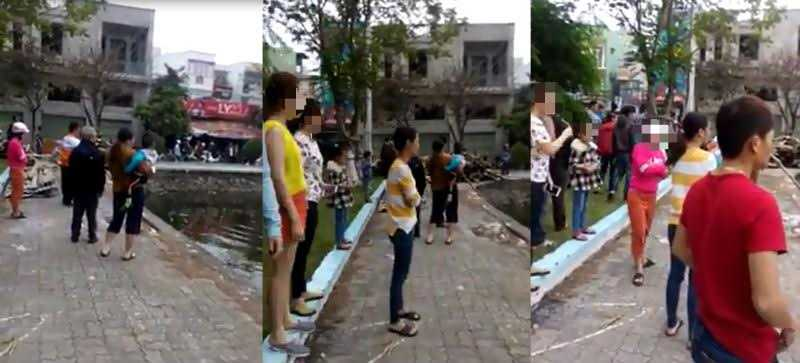Rất đông người dân đứng trên bờ chứng kiến nam thanh niên vùng vẫy rồi chết chìm dưới hồ. 4 công an phường cũng có mặt tại hiện trường nhưng 'bất lực'.
