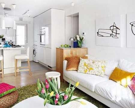 Hệ tủ được thiết kế theo dạng đóng kín để lưu trữ đồ dùng của phòng khách và phòng bếp ví dụ như lò nướng, máy giặt, tạo thành một khối liên hoàn tiện dụng.
