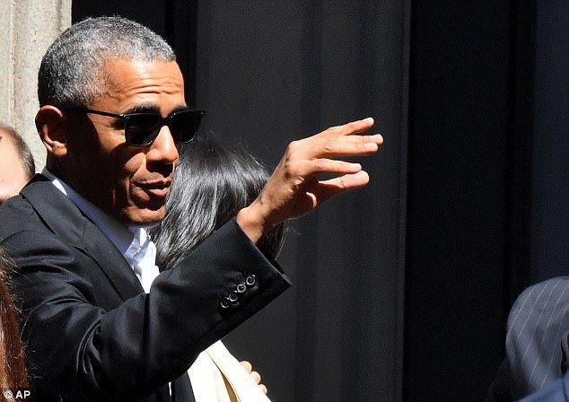Obama xuat hien day phong cach o kinh do thoi trang Milan hinh anh 8